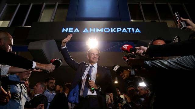 New Democracy conservative party leader Kyriakos Mitsotakis waves as he speaks outside party's headquarters, after the general election in Athens