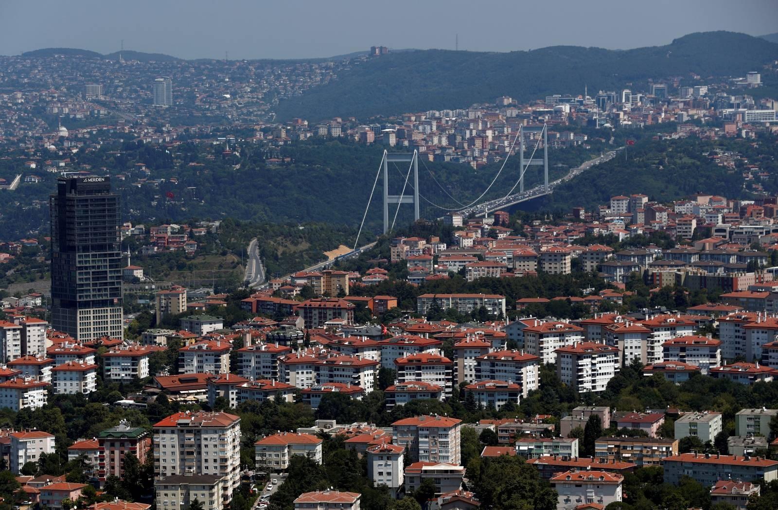 The Fatih Sultan Mehmet Bridge is seen behind residential apartment blocks in Istanbul