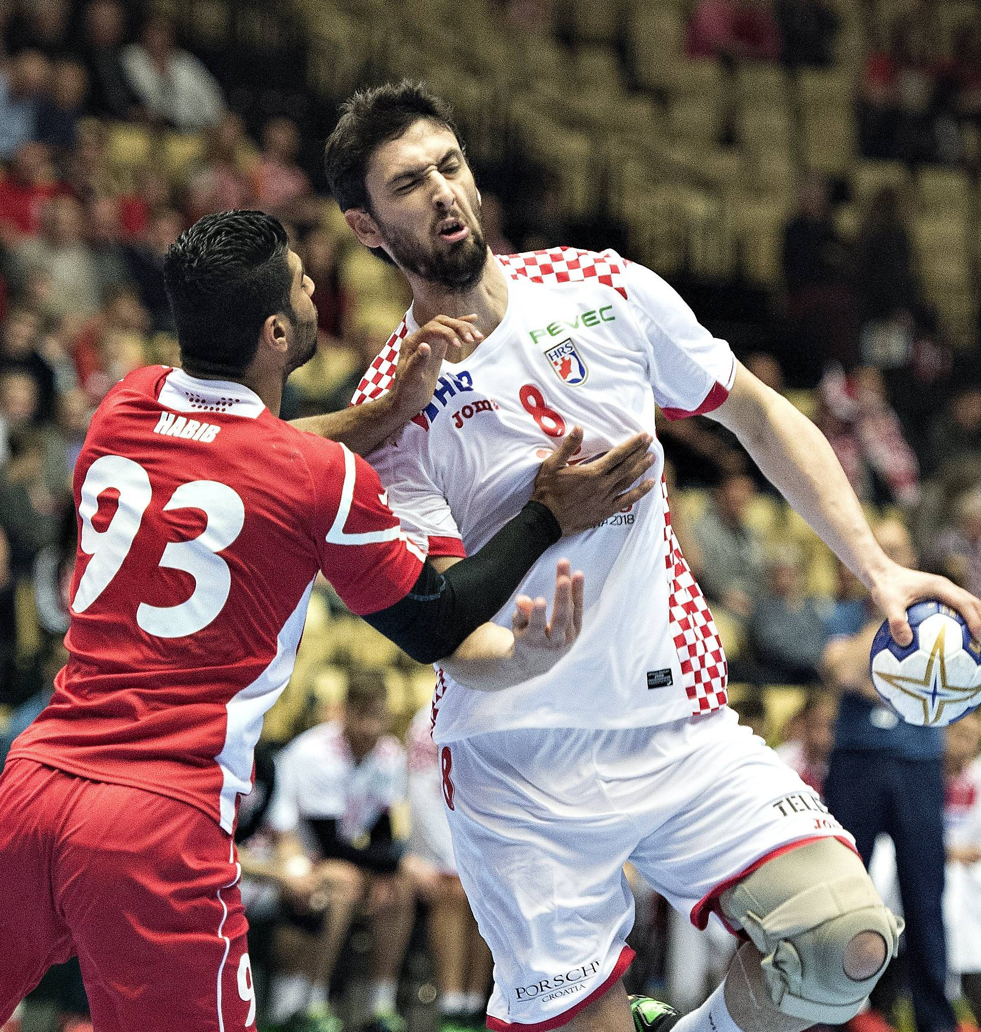 Habib Mohamed of Bahrain and Marko Kopljar of Croatia in action during their men's handball Olympic qualification match in Boxen
