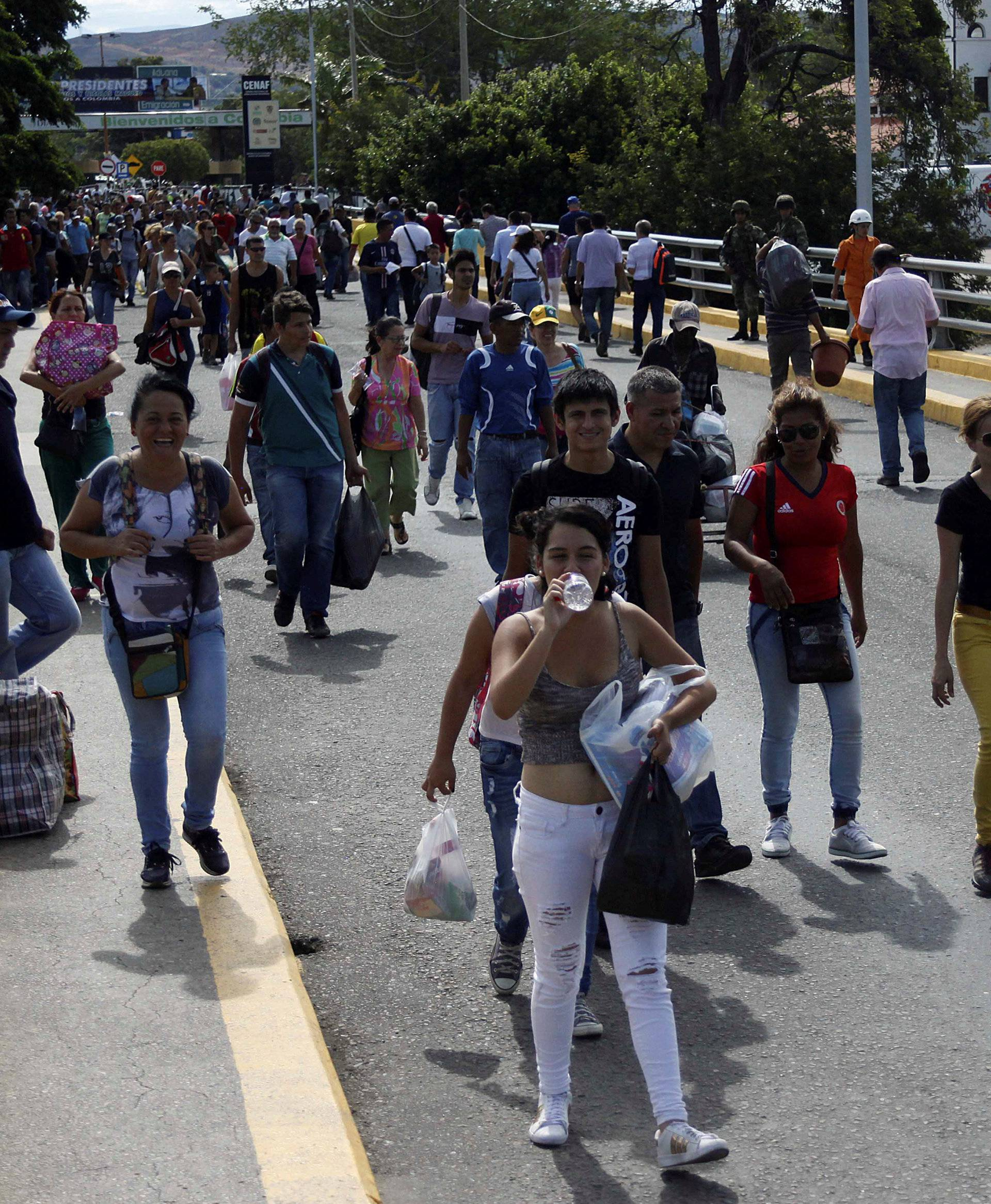 People cross to Venezuela over the Simon Bolivar international bridge after shopping in Cucuta