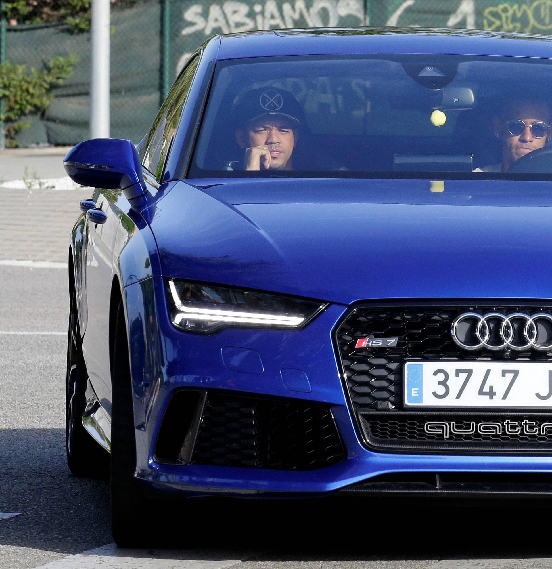 Brazilian soccer player Neymar drives to arrive to Joan Gamper training camp near Barcelona