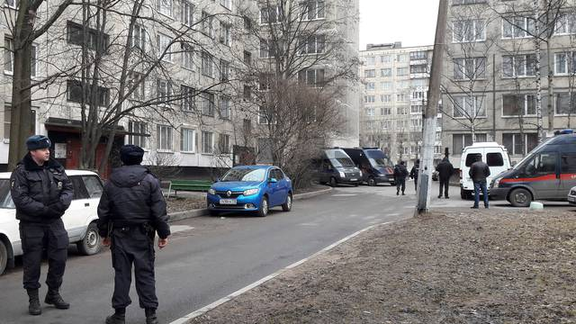 Russian police officers secure a residential area in St. Petersburg