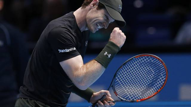 Great Britain's Andy Murray celebrates winning his round robin match against Japan's Kei Nishikori