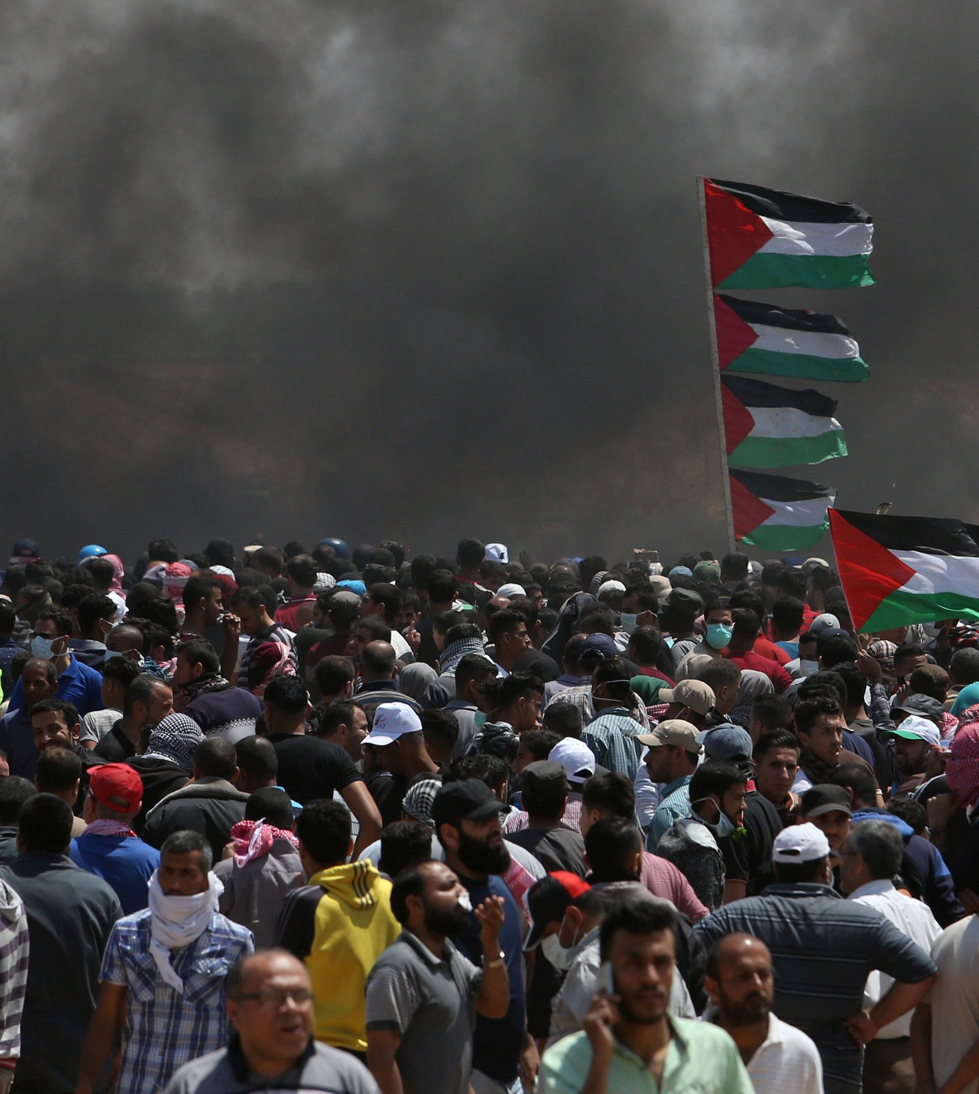 Palestinian demonstrators gather during a protest against U.S. embassy move to Jerusalem and ahead of the 70th anniversary of Nakba, at the Israel-Gaza border in the southern Gaza Strip