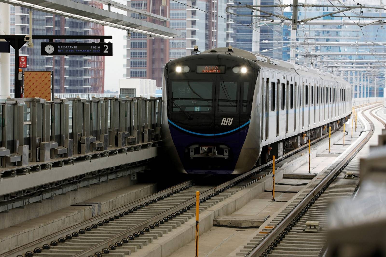 FILE PHOTO: A Mass Rapid Transit (MRT) train arrives at a station during its full trial run in Jakarta