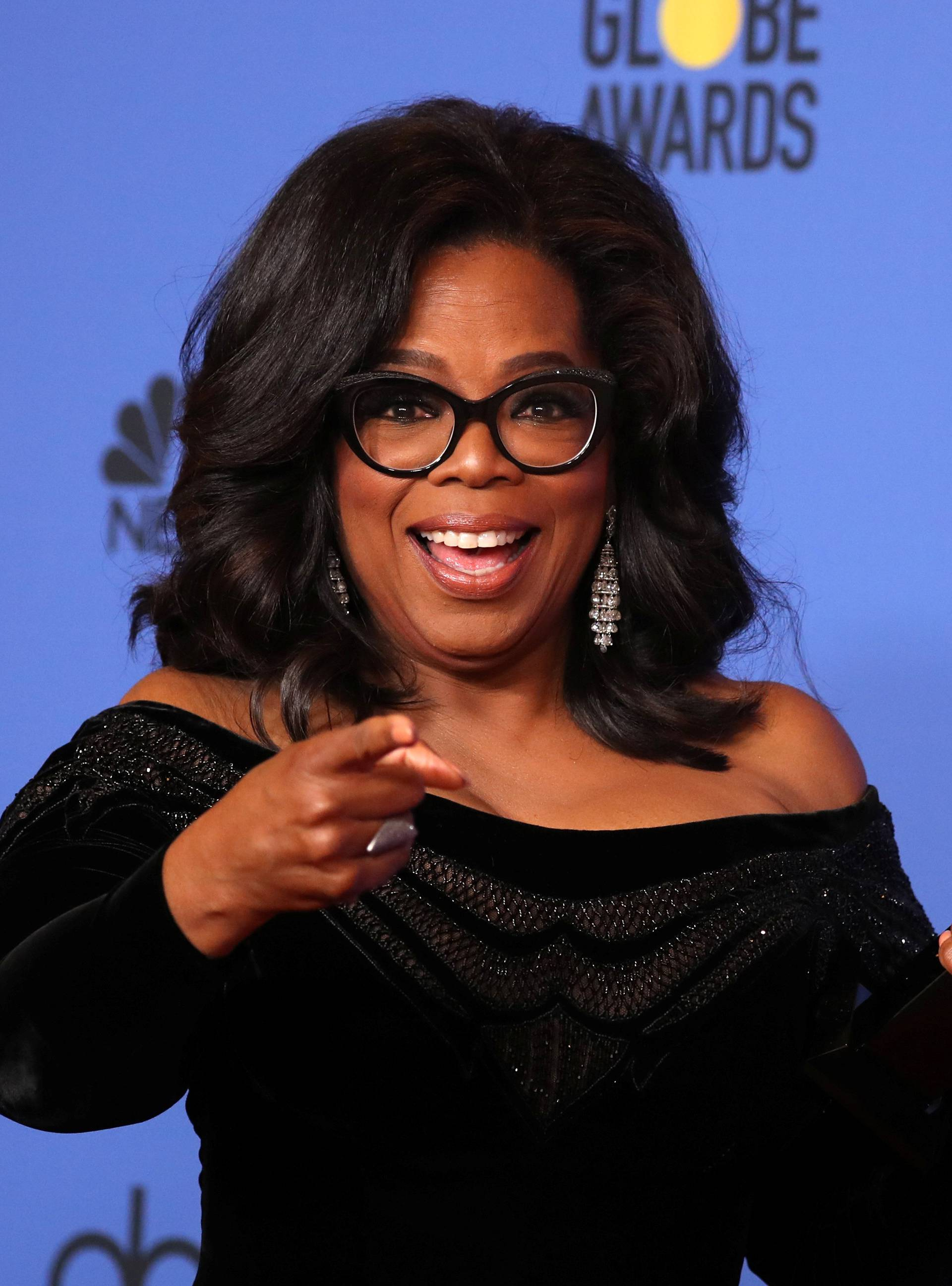 FILE PHOTO: Oprah Winfrey with her Cecil B. DeMille Award at the 75th Golden Globe Awards in Beverly Hills