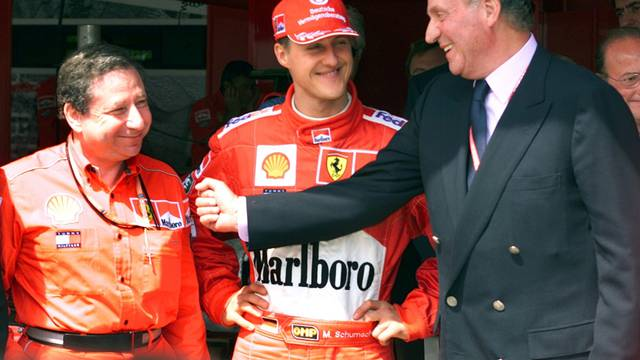 FILE PHOTO:  Spanish King Juan Carlos laughs with German world champion Michael Schumacher and Ferrari team director Jean Todt during a visit to the pits prior to the start of the Spanish Formula One Grand Prix at the Circuit de Catalunya.