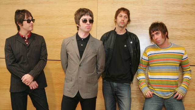 FILE PHOTO: Members of British rock band Oasis pose at news conference in Hong Kong