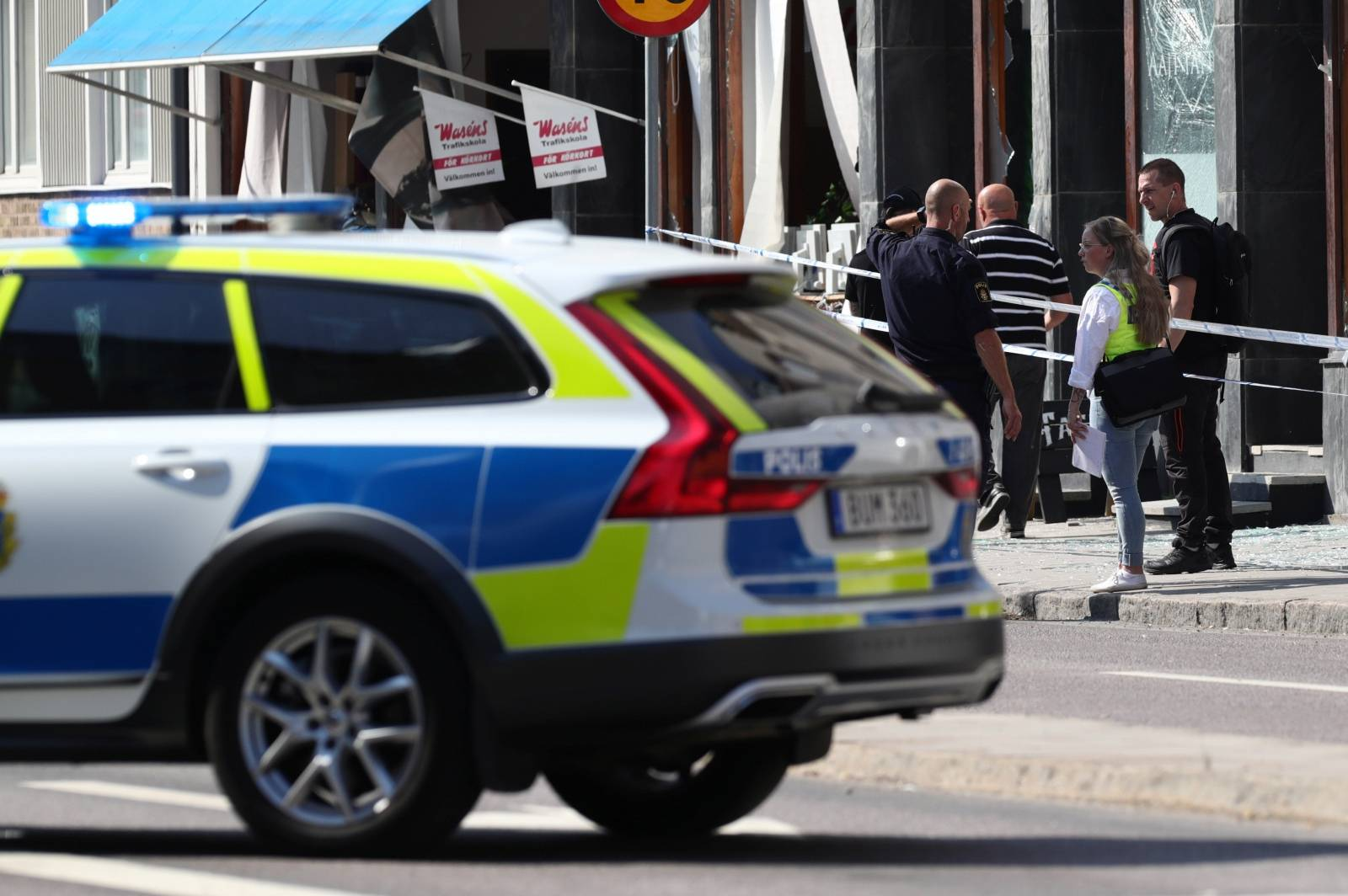 Police officers are seen at the site of an explosion in Linkoping