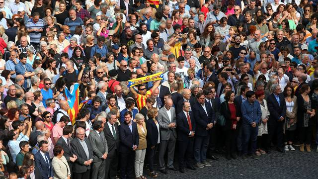 Catalan regional government members and local politicians stand in Plaza Sant Jaume as they join a protest called by pro-independence groups for citizens to gather at noon in front of city halls throughout Catalonia, in Barcelona