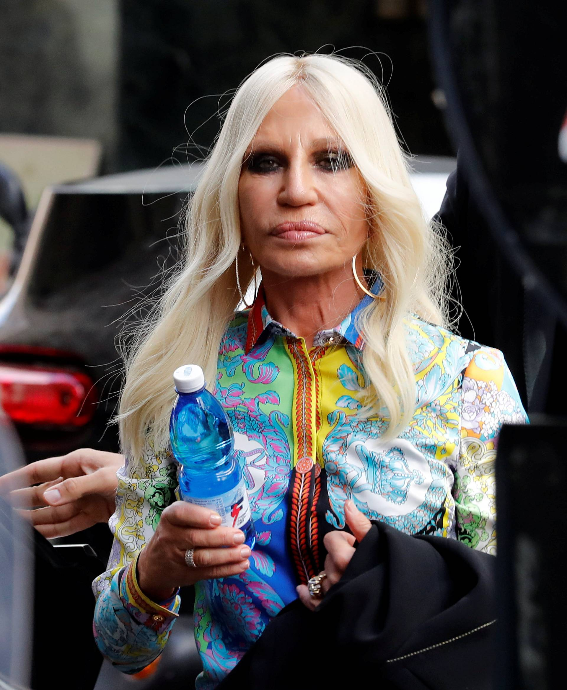 Italian designer Donatella Versace arrives to meet employees in Milan