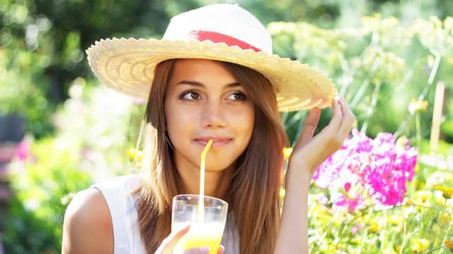 Beautiful girl drinking juice