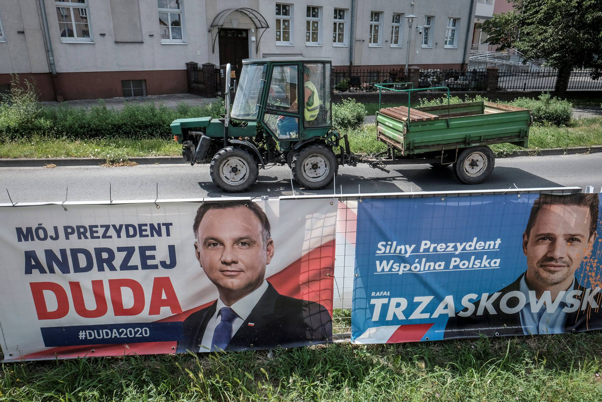 Election posters of Rafal Trzaskowski, the presidential candidate of the main Polish opposition party Civic Platform (PO) and Polish President Andrzej Duda hang on a fence in Leszno