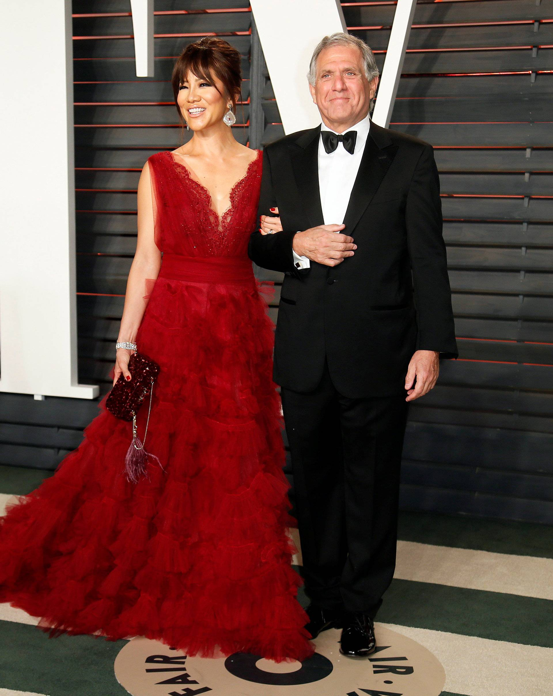 FILE PHOTO: Les Moonves and his wife, Julie Chen, arrive at the Vanity Fair Oscar Party in Beverly Hills