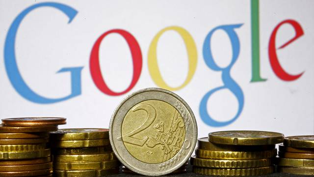 FILE PHOTO: Euro coins are seen in front of a Google logo in this picture illustration