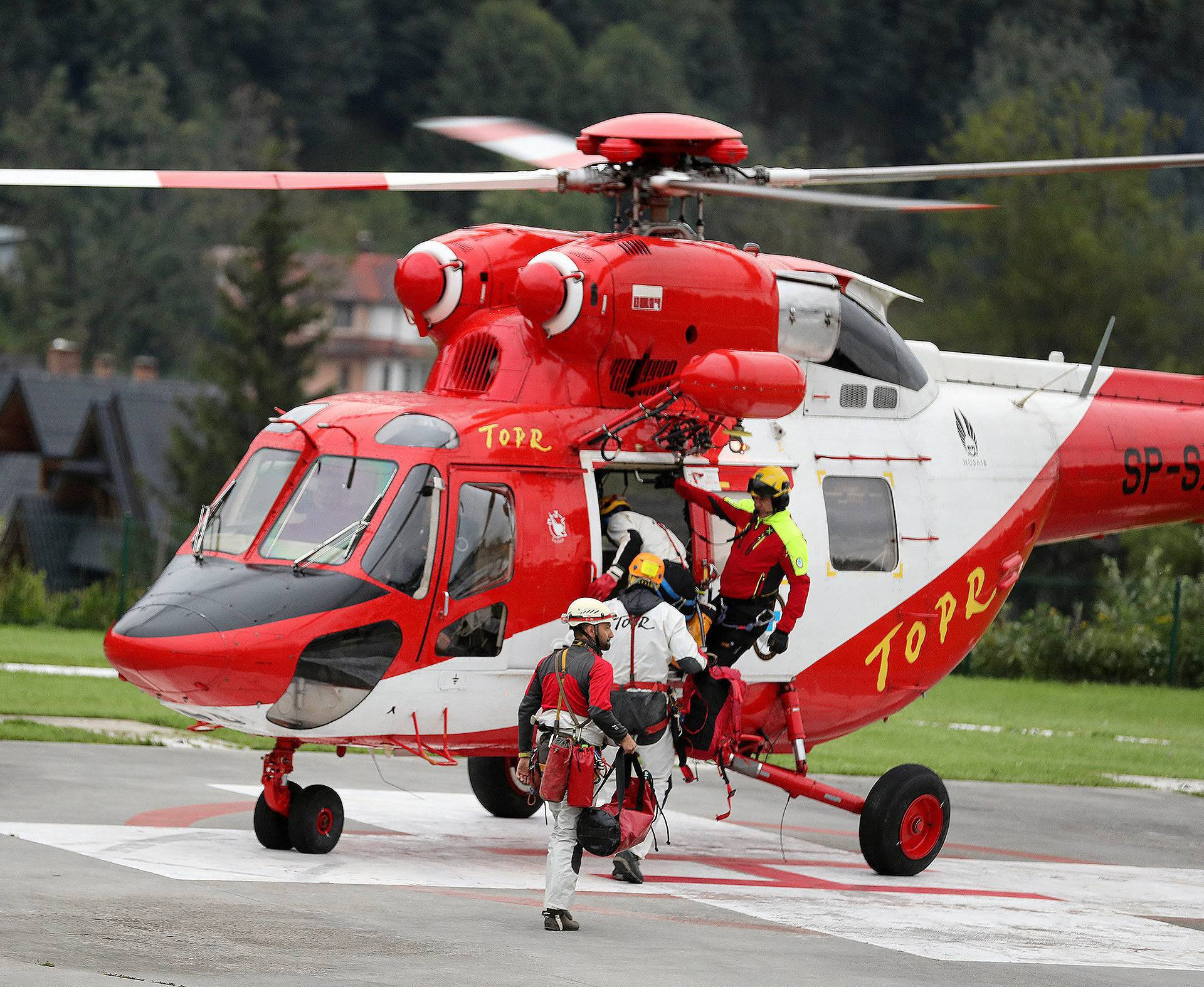 Mountain rescue team (TOPR) members board a helicopter in Zakopane