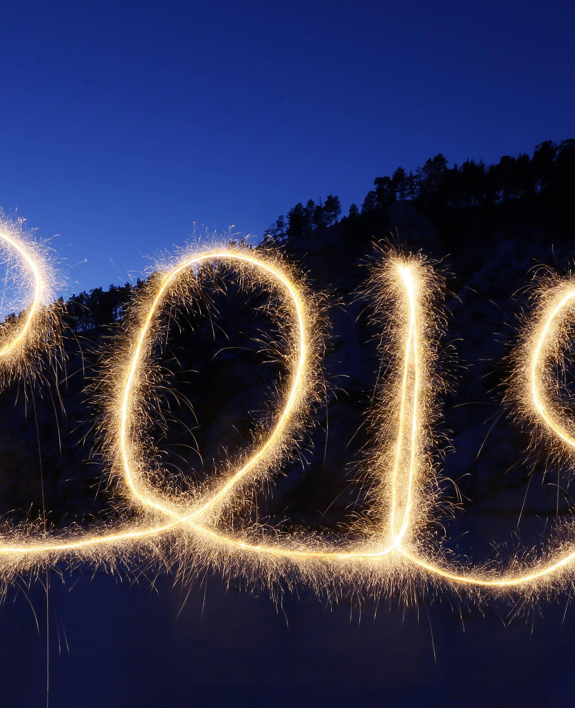 """The numbers """"2019"""" are written in the air with a sparkler near a tourist camp outside Krasnoyarsk"""