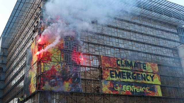 Greenpeace protests outside the EU Council headquarters in Brussels