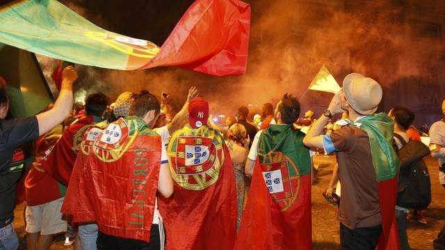 Portugal fans react on the Champs-Elysees after their team won the EURO 2016 final soccer match