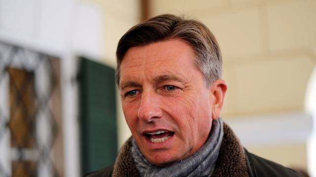 Current President and presidential candidate Borut Pahor speaks to the press after voting at a polling station during the second round of the presidential election in Sempeter pri Novi Gorici