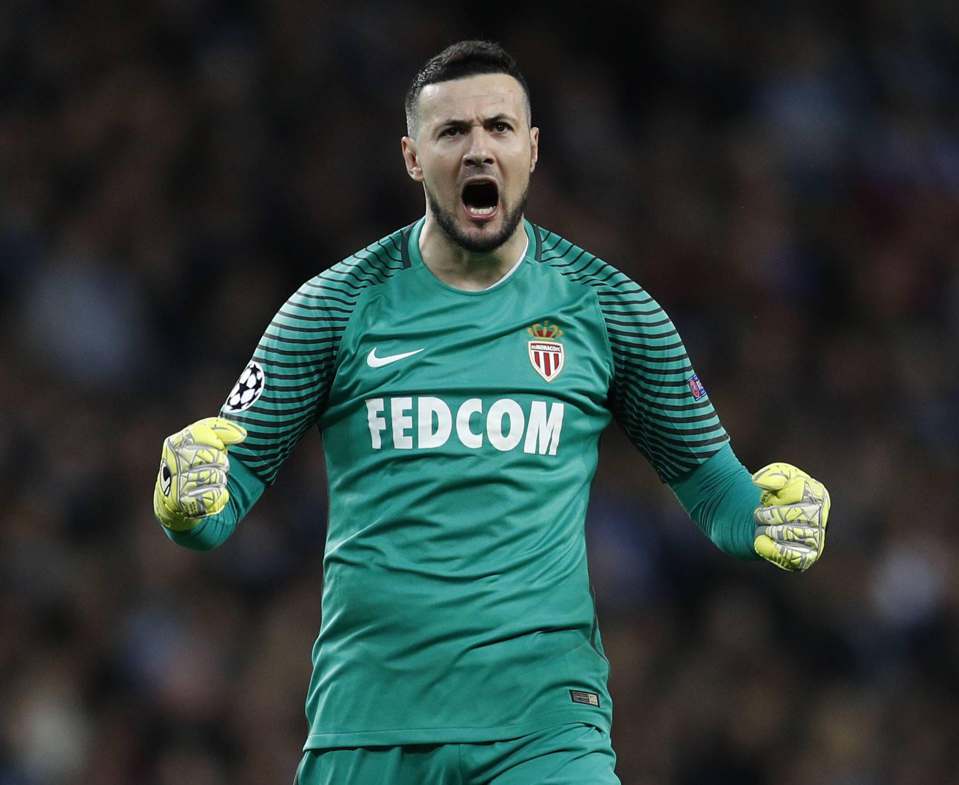 Monaco's Danijel Subasic celebrates their first goal