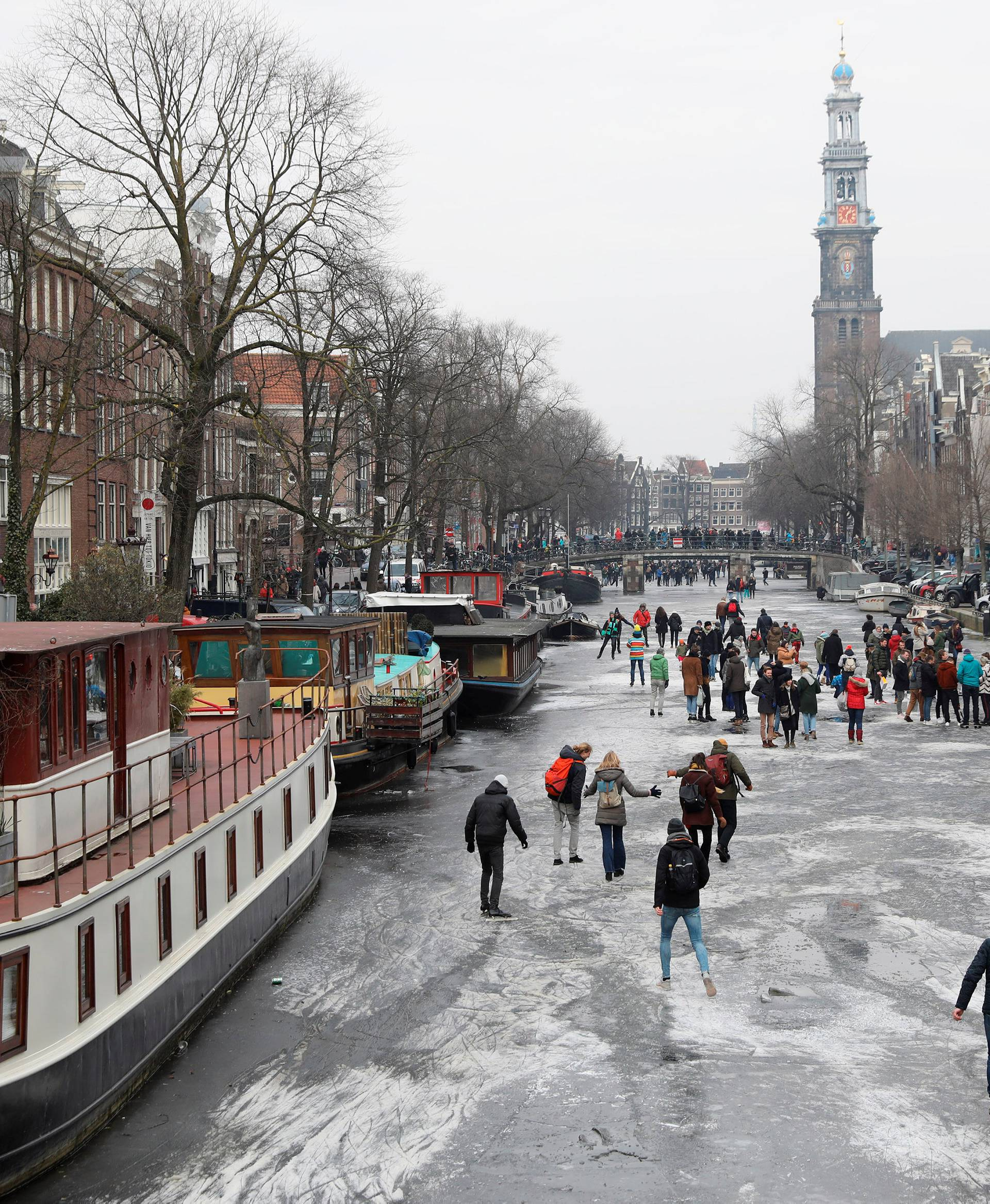 Ice skaters skate on the frozen Prinsengracht  canal during icy weather in Amsterdam,