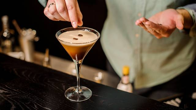 classy bartender espresso cocktail drink white foam coffee bean