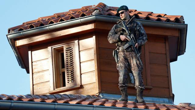 A member of Turkish police special forces stands guard next to the Eyup Sultan mosque in Istanbul, Turkey