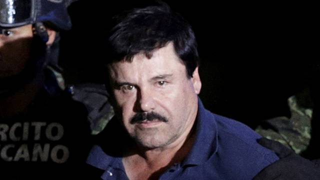 """FILE PHOTO: Recaptured drug lord Joaquin """"El Chapo"""" Guzman is escorted by soldiers at the hangar belonging to the office of the Attorney General in Mexico City"""