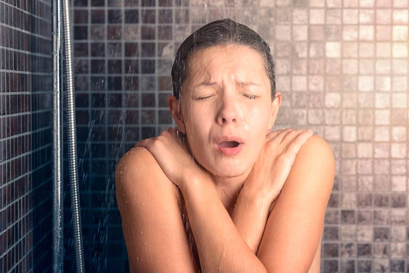 Bare Woman Reacting While Taking Cold Shower