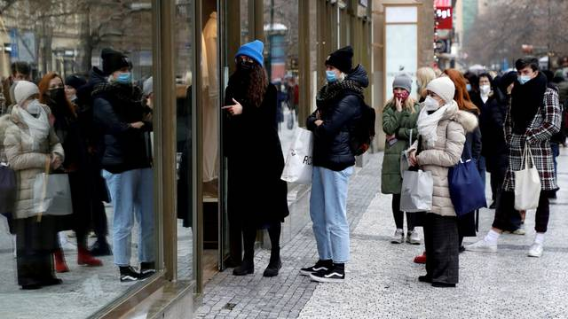 FILE PHOTO: Customers queue in front of a reopened shop during the coronavirus outbreak in Prague, Czech Republic