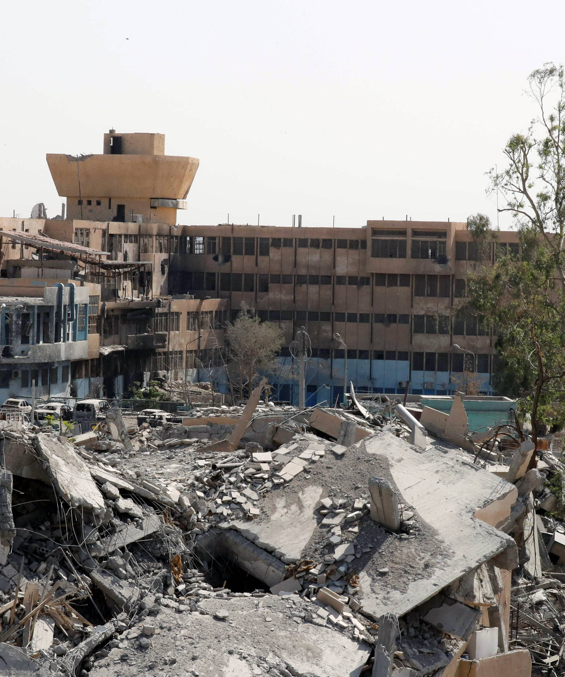 The National Hospital, last stronghold of the Islamic state militants, is pictured from the positions of the Syrian Democratic Forces at the frontline in Raqqa