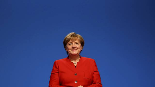 German Chancellor and leader of the conservative CDU Merkel reacts after she was re-elected as chairwoman at the CDU party convention in Essen
