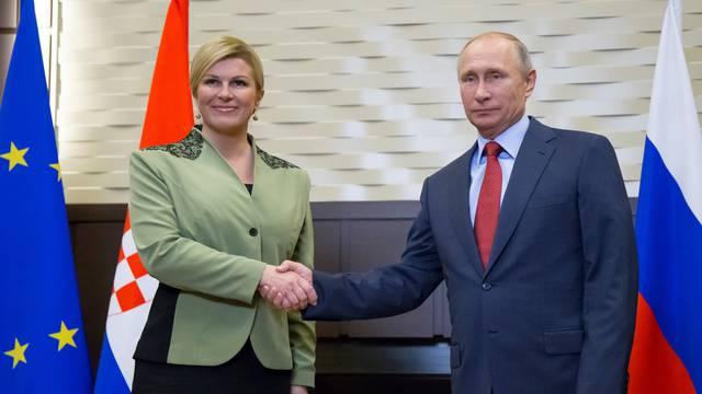 Putin shakes hands with Croatian President Kolinda Grabar-Kitarovic during their meeting in Sochi