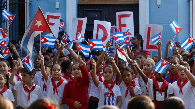 Children perform an act in a school to commemorate the first anniversary of the death of Cuba's late president Fidel Castro, in Havana