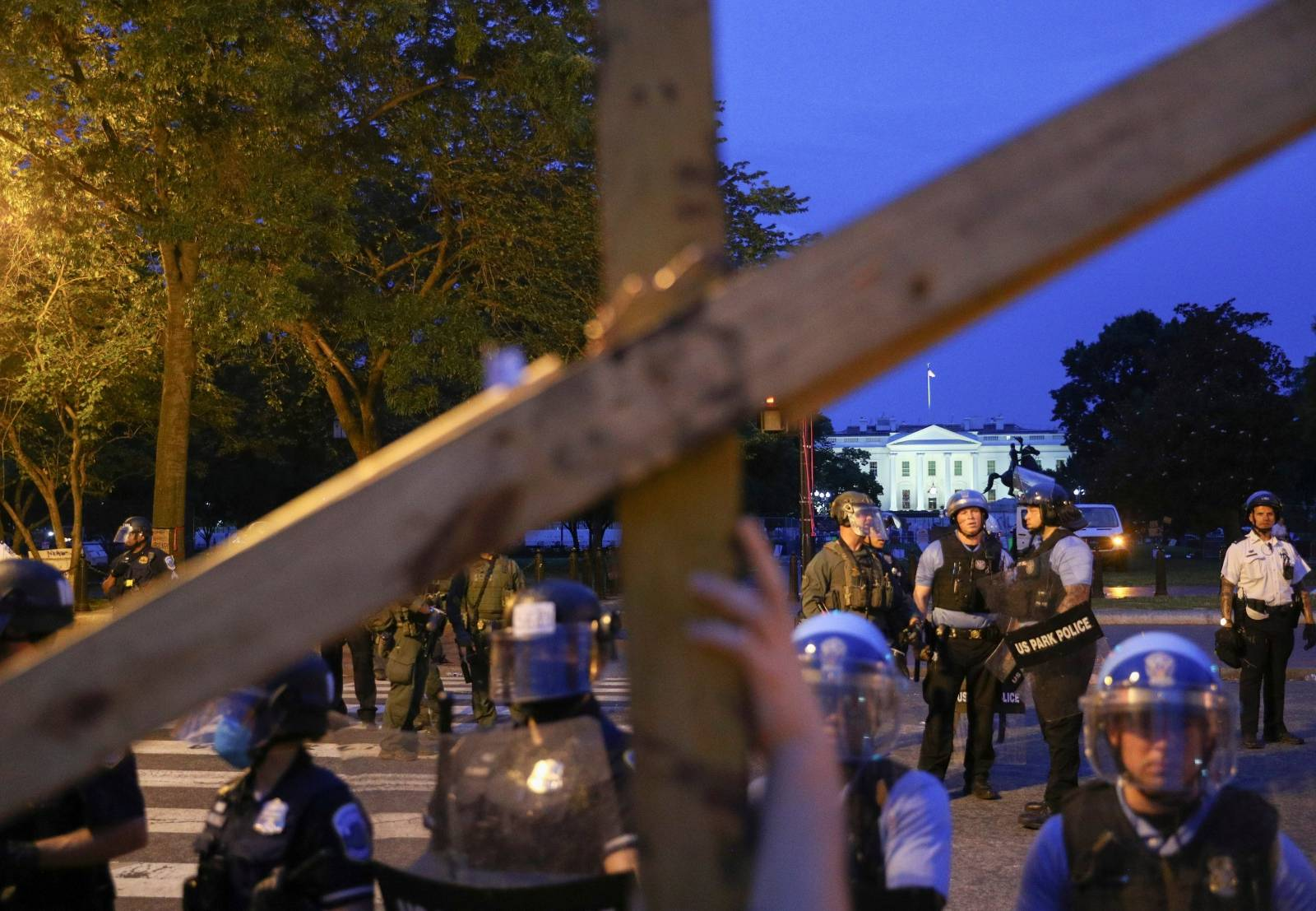 Protestors and police face off by the White House after clashes between police and protestors attempting to pull down statue of U.S. President Andrew Jackson in Washington