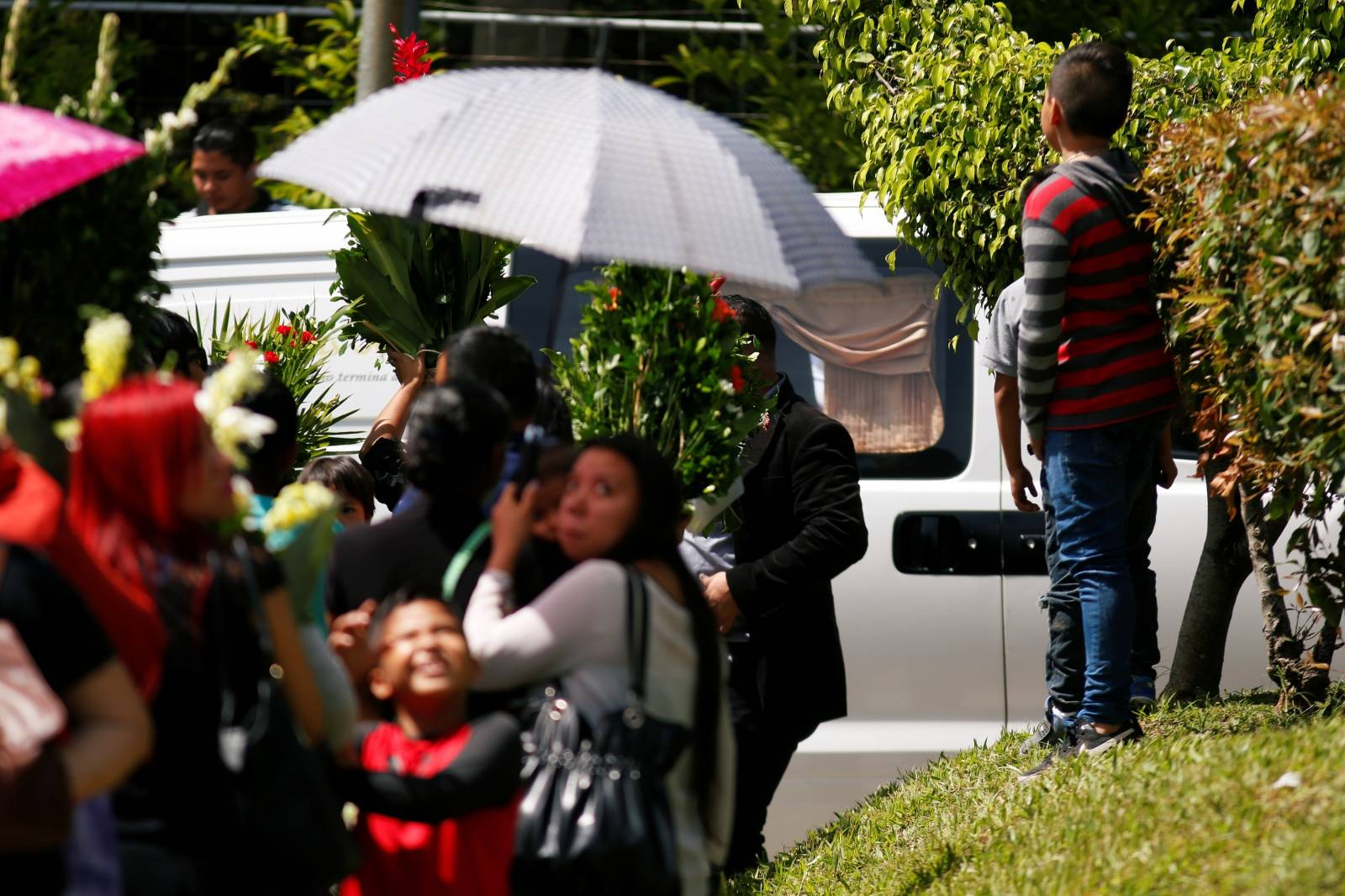 Family and friends participate in the funeral of Oscar Alberto Martinez Ramirez and his daughter Valeria, migrants who drowned in the Rio Grande river during their journey to the U.S., at La Bermeja cemetery in San Salvador