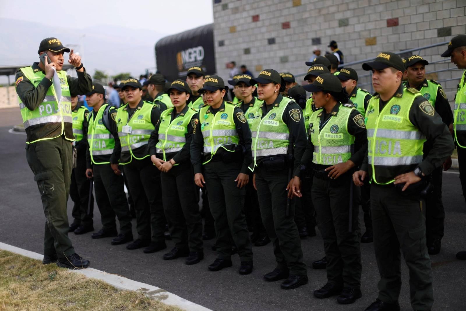 Colombian police officers arrive to the Tienditas cross-border bridge between Colombia and Venezuela in Cucuta