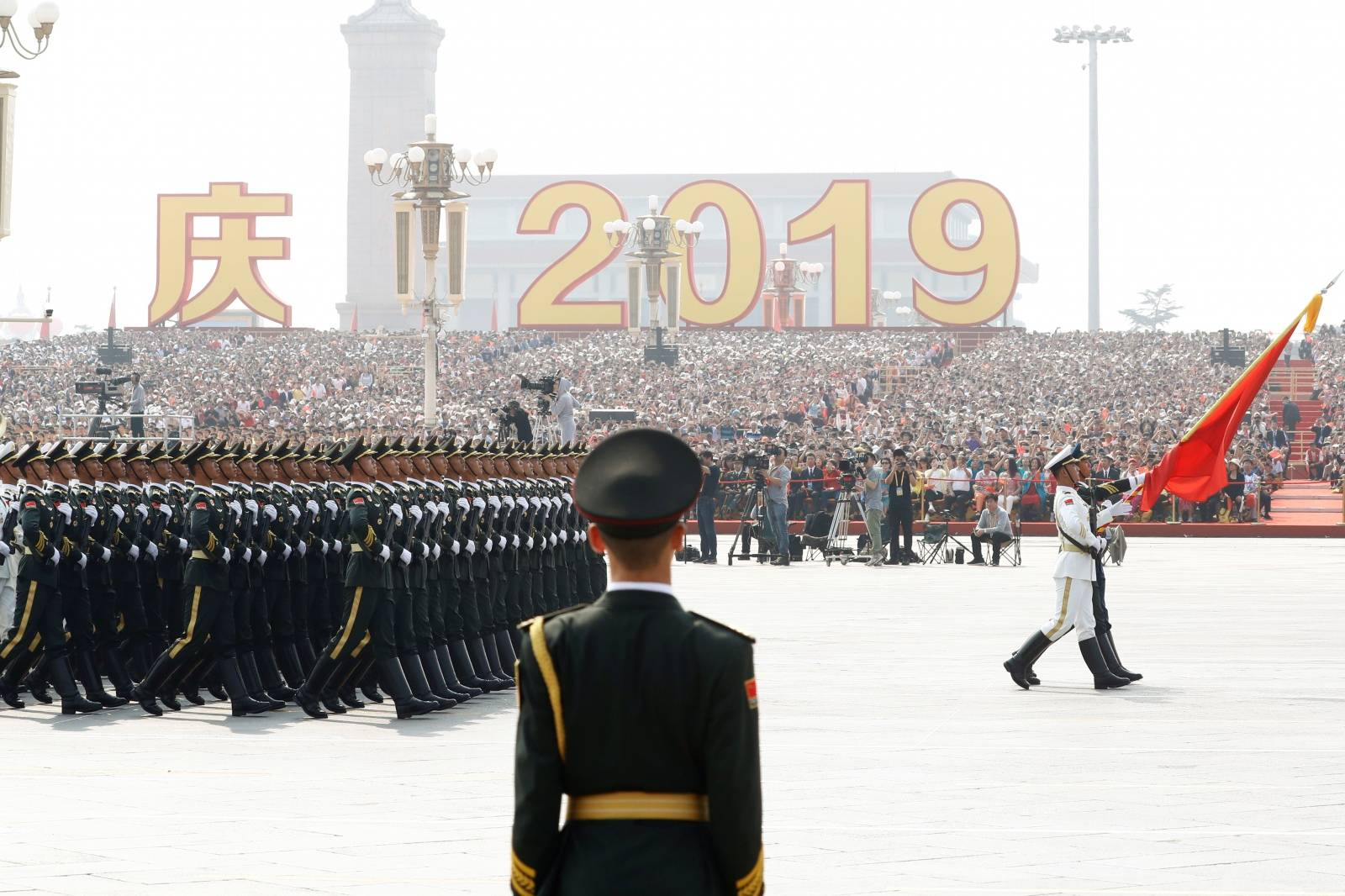 Soldiers of People's Liberation Army (PLA) march in formation past Tiananmen Square during the military parade marking the 70th founding anniversary of People's Republic of China