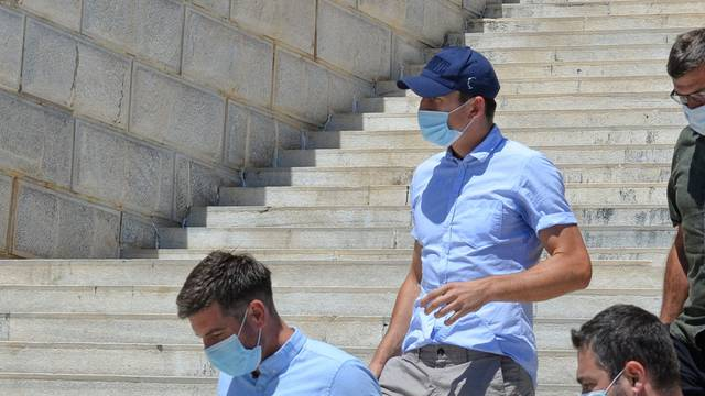 Manchester United captain Harry Maguire, who was detained on the island of Mykonos, leaves a court building on the island of Syros
