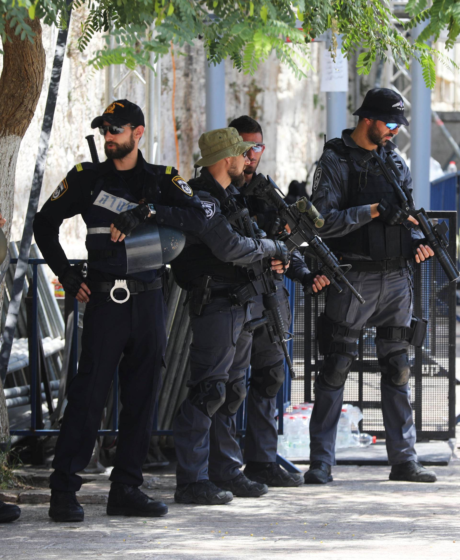 Israeli police officers stand guard next to recently installed metal detectors at an entrance to the compound known to Muslims as Noble Sanctuary and to Jews as Temple Mount in Jerusalem's Old City