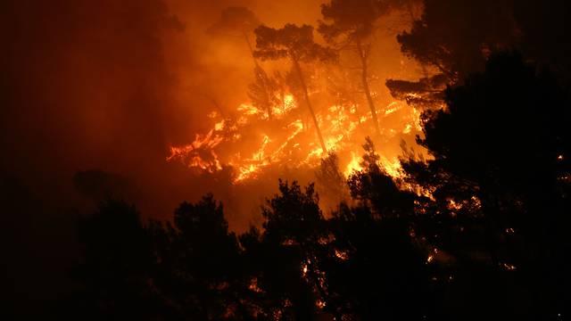 A wildfire is seen in the village of Mravince near Split