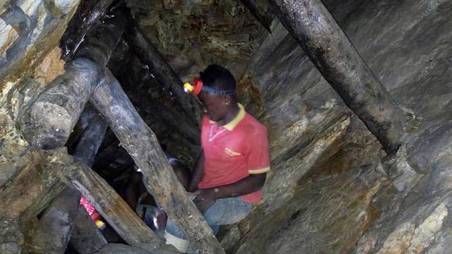A Congolese miner works at an artisanal gold mine near Kamituga