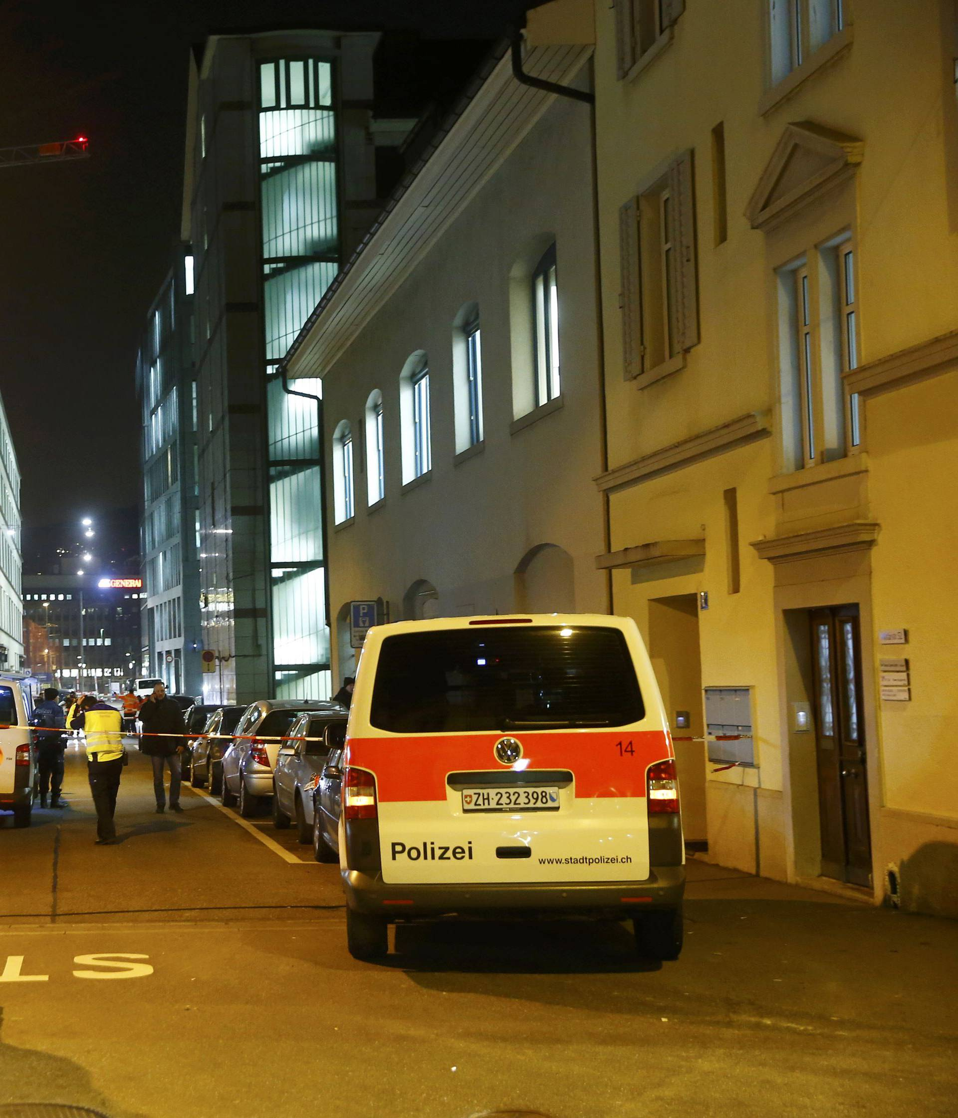 Police stand outside an Islamic center in central Zurich
