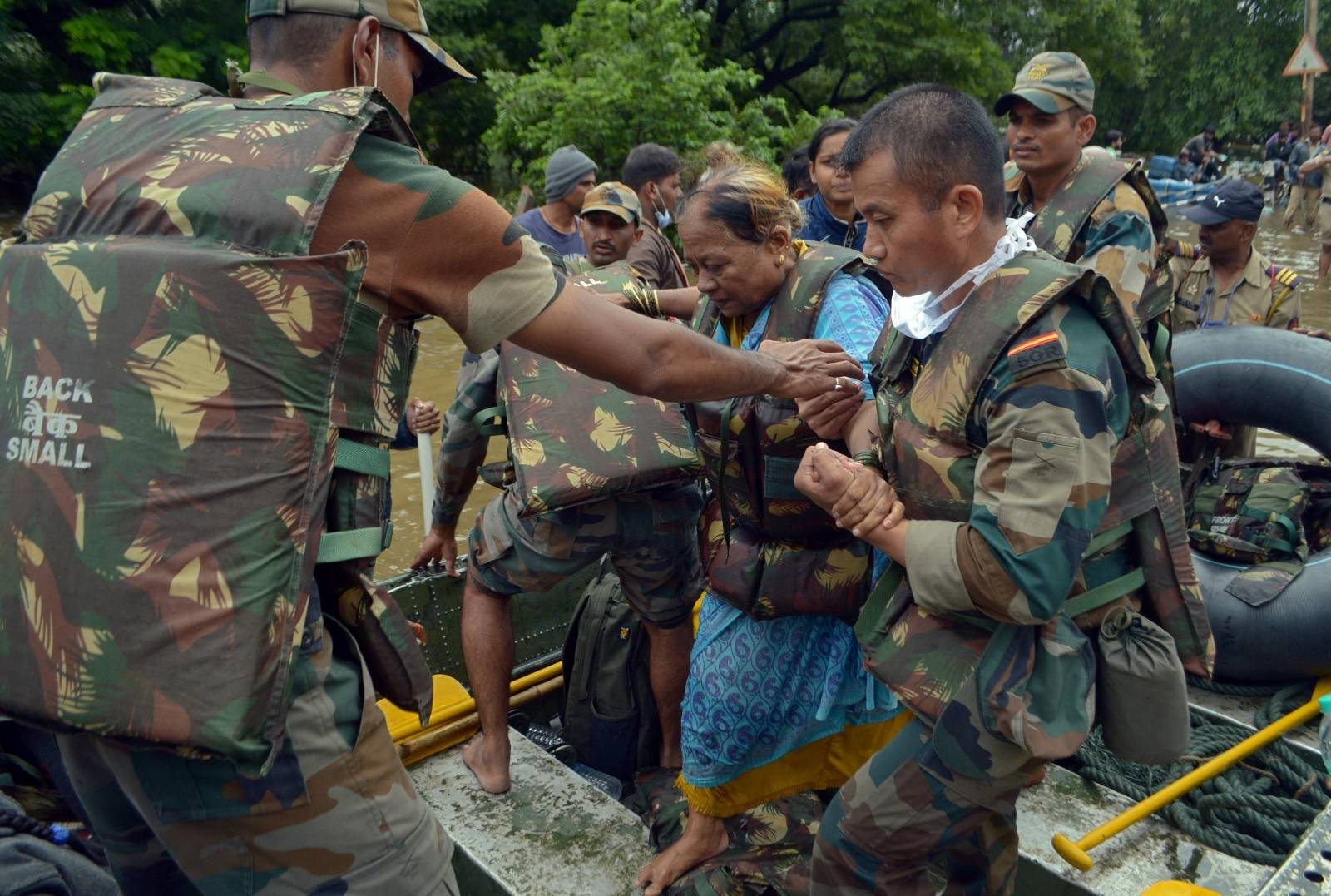 Army soldiers evacuate a flood-affected woman to a safer place in Sangli district
